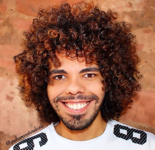 men's afro hairstyle with highlights