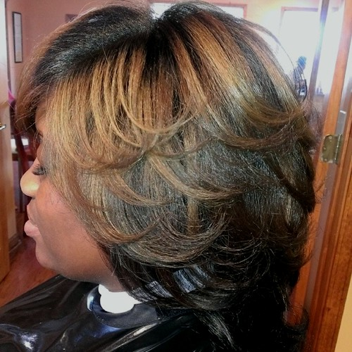 medium layered brunette hairstyle with caramel highlights