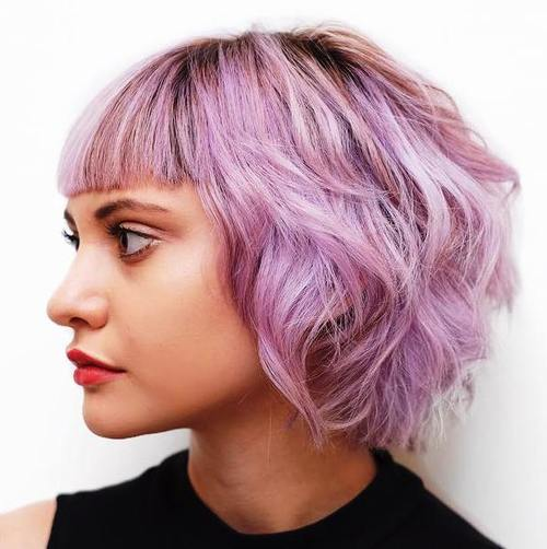 pastel purple wavy bob with bangs