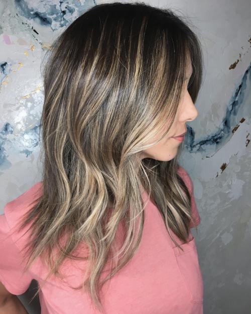 Long Highlighted Hairstyle With Razored Ends