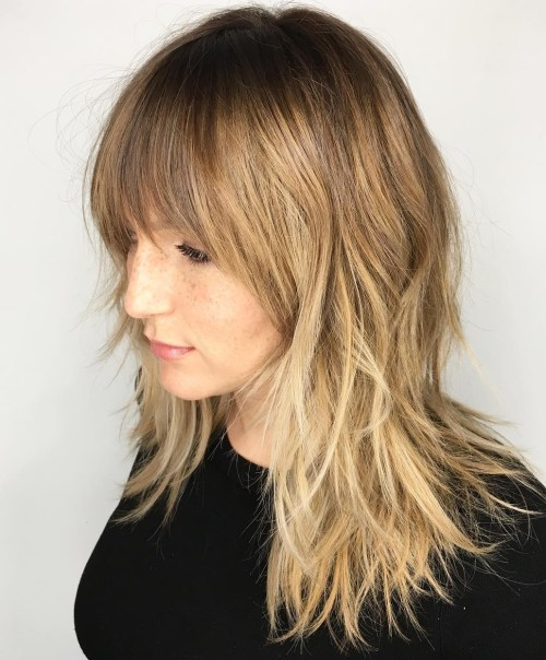 Shoulder-Length Shaggy Haircut With Bangs