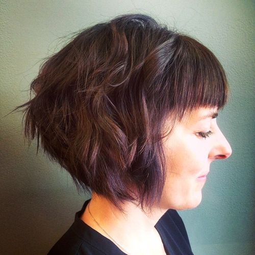 shaggy brunette bob with bangs