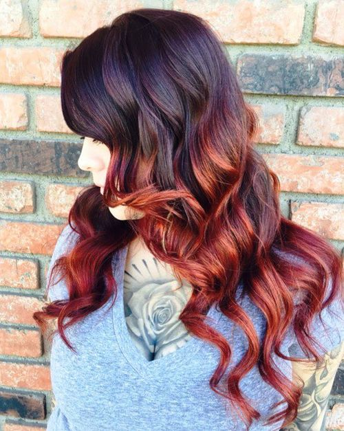 black hair with burgundy and caramel balayage