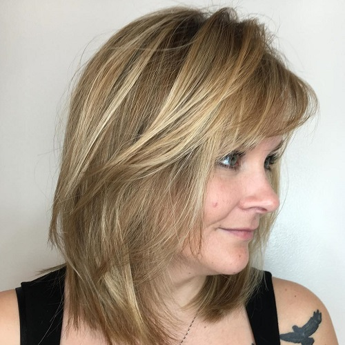 Medium Layered Haircut With Bangs