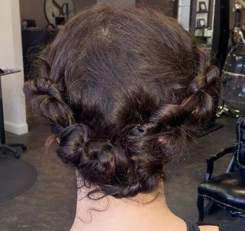 messy knotted roll updo