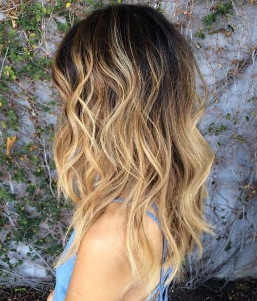 Blonde Wavy Hair With Black Root Fade