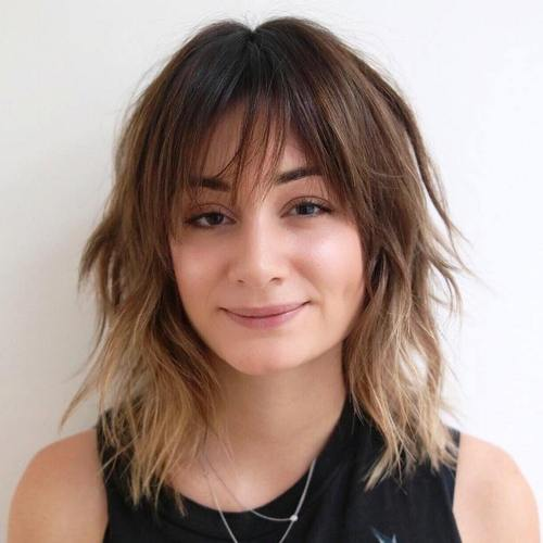 medium shaggy haircut with bangs and ombre