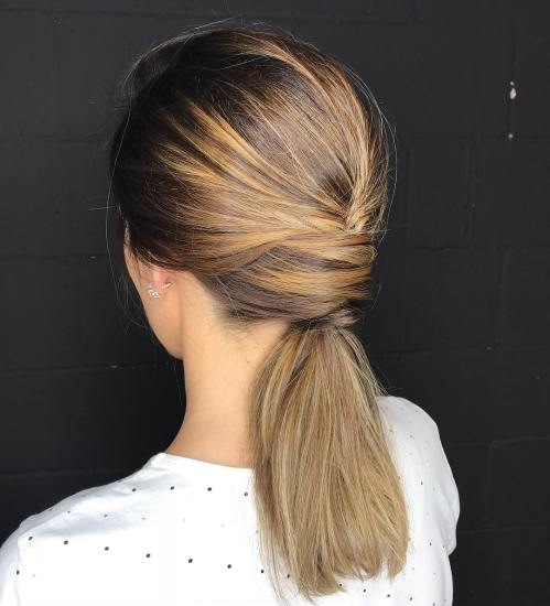 Sleek Low Ponytail With A Twist