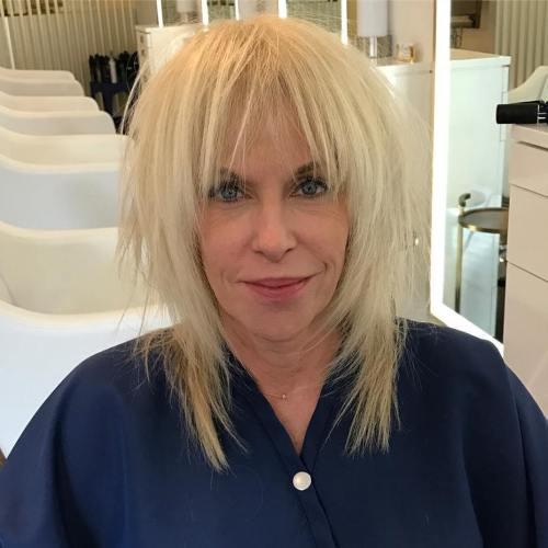 Over Medium Layered Haircut With Bangs