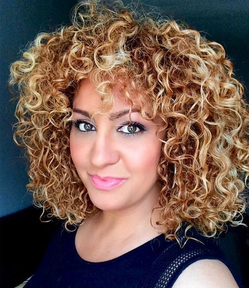 curly caramel hair with blonde highlights
