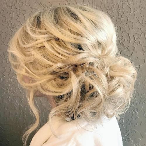Low Disheveled Blonde Updo