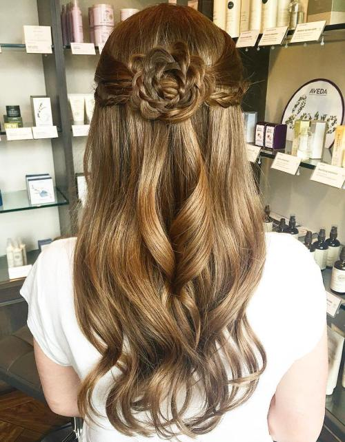 Half Up Hairstyle With A Braided Flower