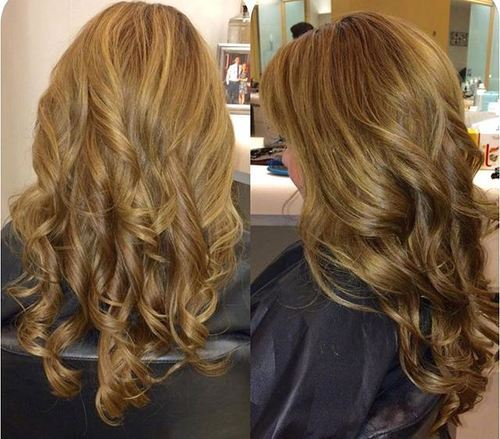 Dark brown curly hair with blonde highlights