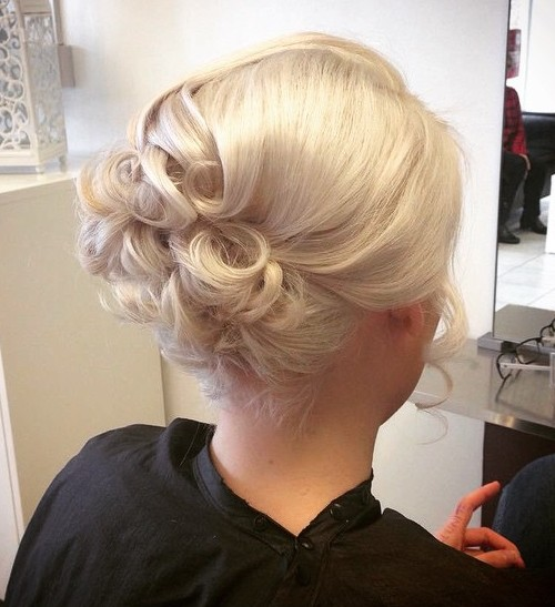 formal blonde curly updo for shorter hair