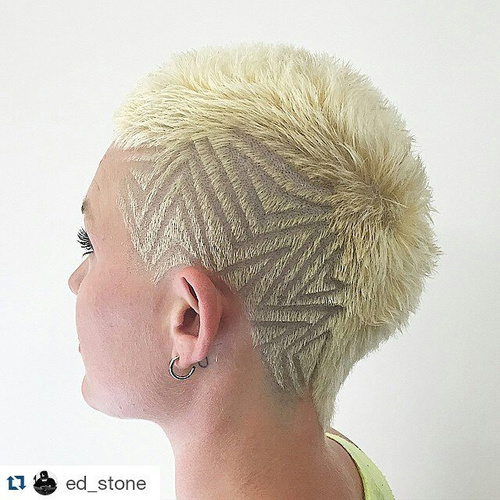 very short blonde haircut with undercut design