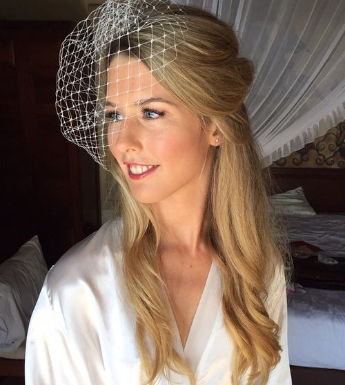 half up wedding hairstyle with birdcage veil