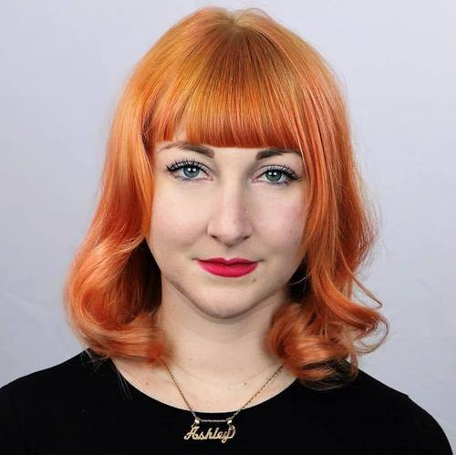 Pastel Orange Hairstyle With Bangs