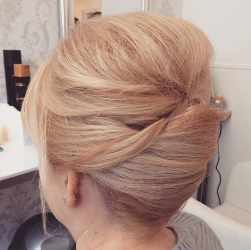 french roll formal updo with a bouffant