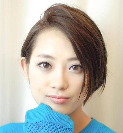 short side-swept brunette hairstyle