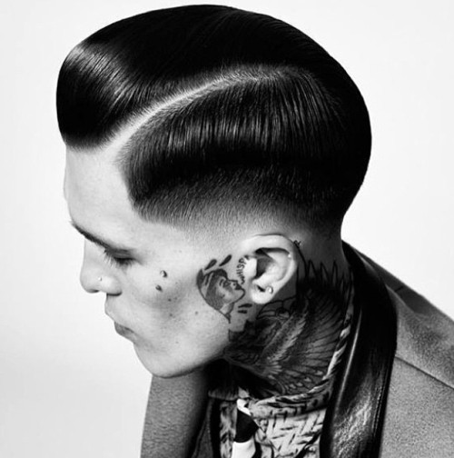 sleek side-parted boys hairstyle