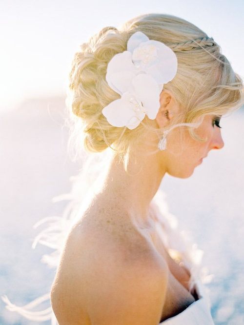 updo with hair flowers for beach wedding
