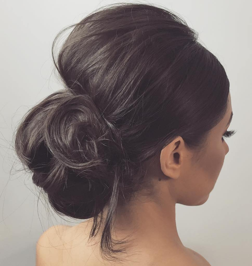 40 irresistible hairstyles for brides and bridesmaids low bun with a bouffant urmus Image collections