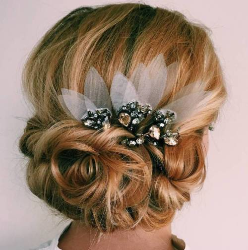 40 chic wedding hair updos for elegant brides low bridal updo with a hair piece pmusecretfo Gallery