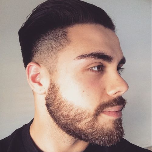 Shaved Sides Combed Back Hairstyle With Beard