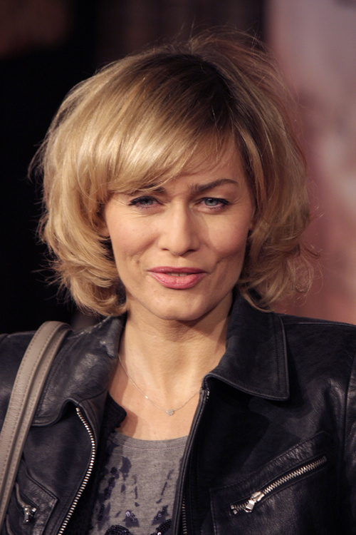 Voluminous curly bob with bangs