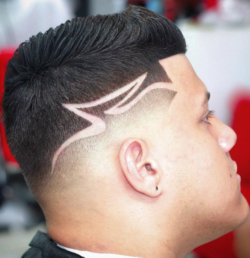 taper fade haircut with shaved lines