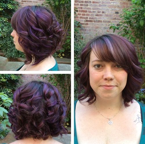 Dark brown hair with purple highlights and bangs