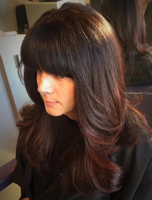 Long Layered Haircut With Thick Bangs