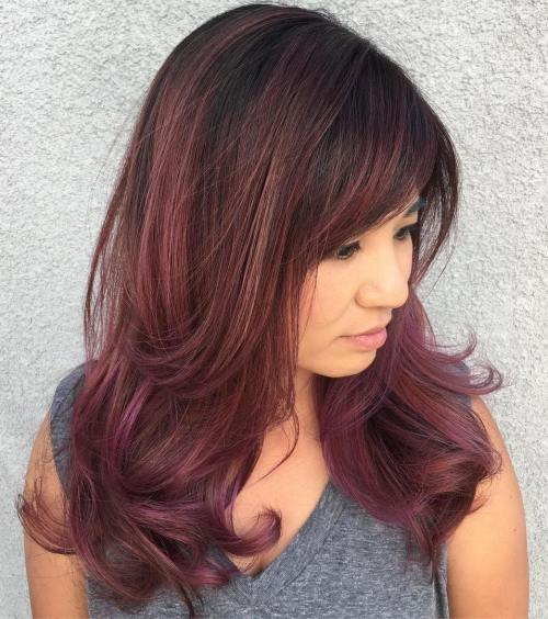 Medium-To-Long Burgundy Hairstyle With Bangs