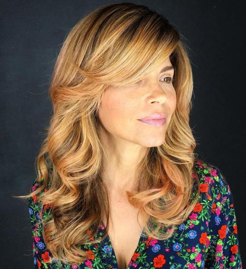 Golden Blonde Layered Hairstyle With Side Bangs