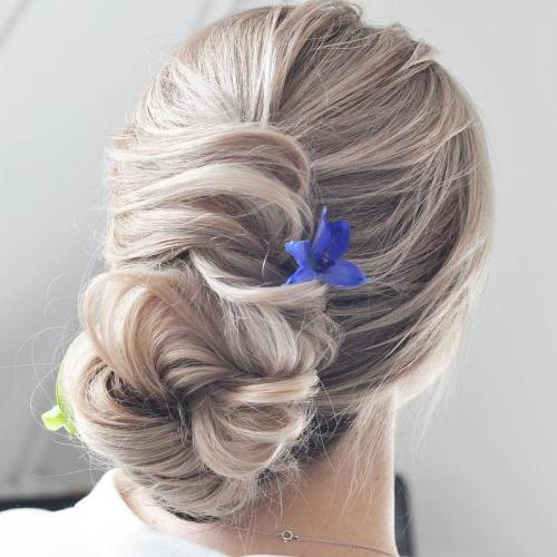 Loose Twisted Messy Bun For Long Hair
