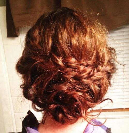 40 creative updos for curly hair messy loose updo with two braids solutioingenieria Choice Image