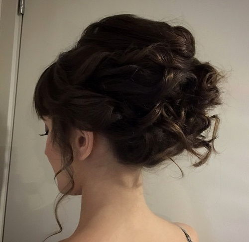 cute voluminous updo for curly hair