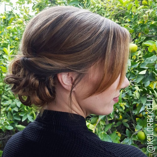Low Curly Bun With Side Bangs