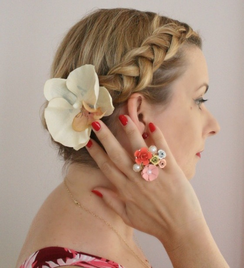 braided vintage updo with a hair flower