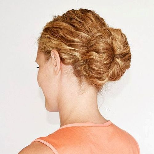 low sock bun for curly hair