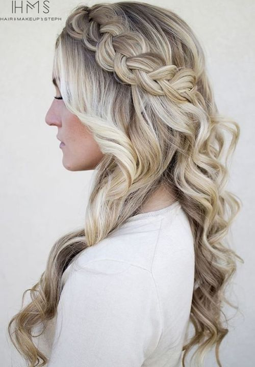 blonde curly hairstyle with a Dutch crown braid