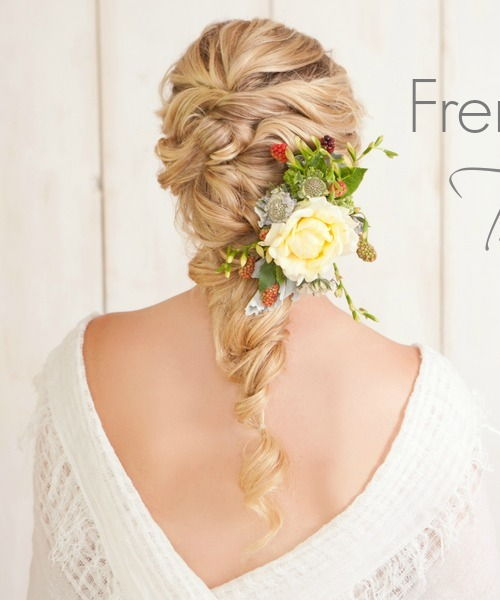 Loose twisted hairstyle with flowers