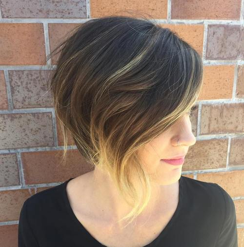wispy asymmetrical brown bob with blonde balayage