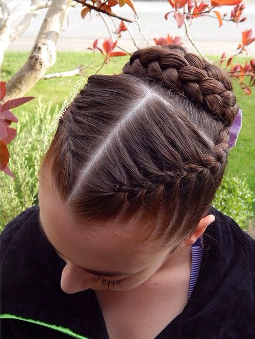 two braids and a braided bun updo