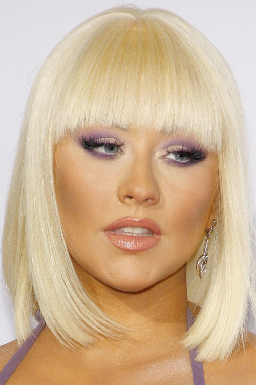blonde angled bob haircut with straight bangs