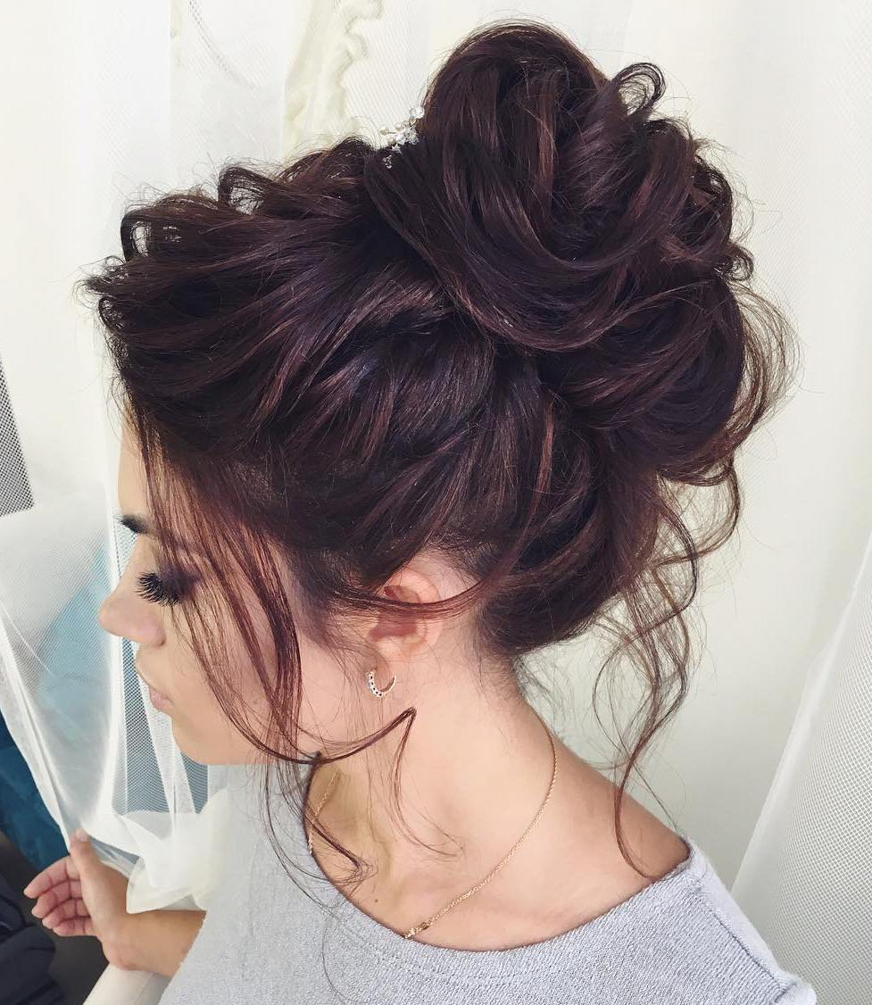 Delightful Curly Messy Bun Long Hair