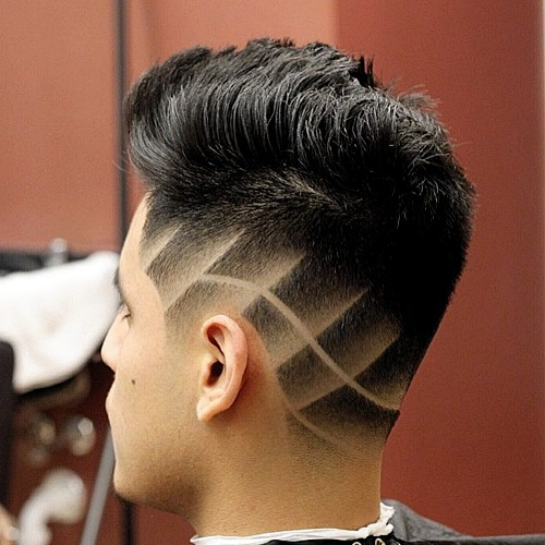 tapered haircut with shaved designs
