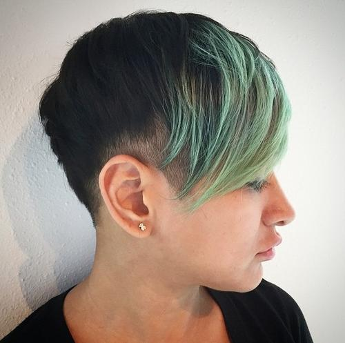 extra short black pixie with green bangs