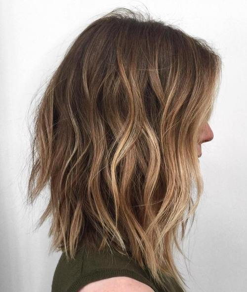 long choppy bob with light brown balayage