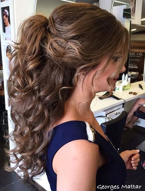 curly half ponytail hairstyle